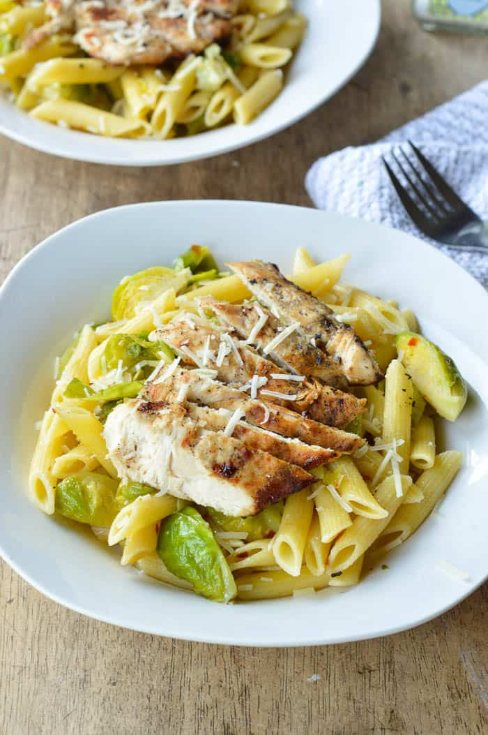 Quick pasta recipe with Grilled Chicken and Brussels sprouts served up in white pasta dishes