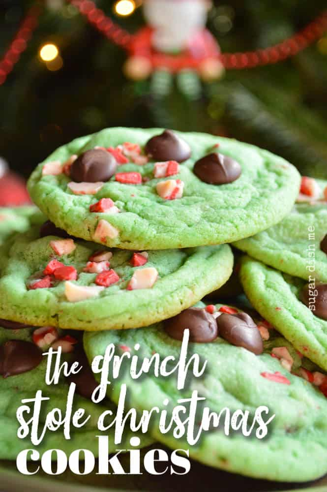The Grinch Stole Christmas Cookies are soft, chewy, and minty green. Studded with Andes Peppermint Crunch Chips and dark chocolate, piled up on a plate under the tree, ready for Santa!