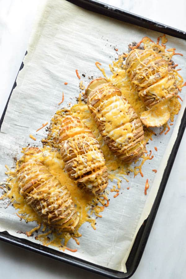 Chili Spiced Hasselback Potatoes covered in cheese