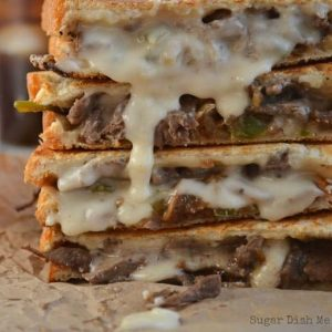 Philly Steak and Grilled Cheese sandwiches stacked and oozing with melted horseradish cheddar