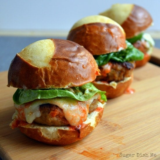 Buffalo Turkey Sliders lined up on a cutting board and ready to impress your appetizer-eating guests!