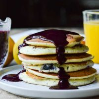 Lemon Poppy Seed Ricotta Pancakes with Blueberry Syrup