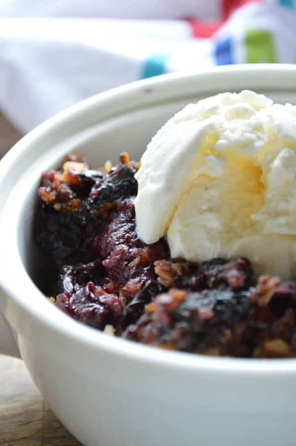 Slow Cooker Blueberry Coconut Cobbler warmed with ice cream on top