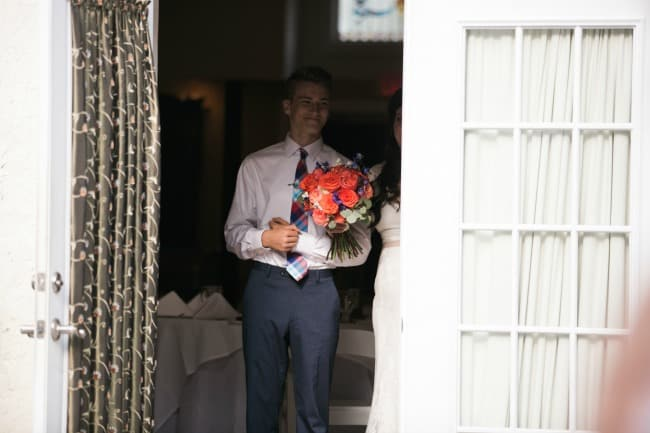 The Gardens at Lake Lure Inn, son holds bouquet and prepares to walk his mom down the aisle