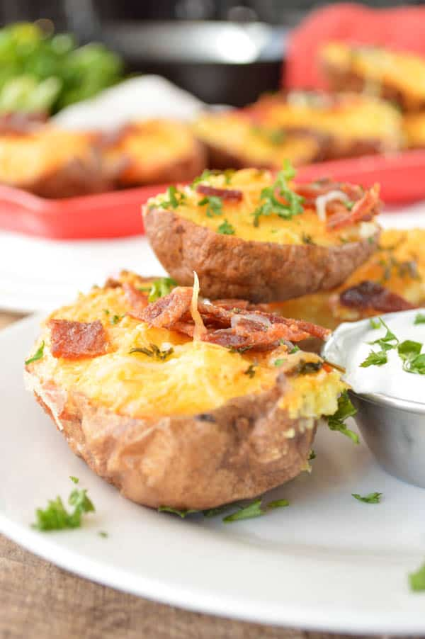 Twice Baked Breakfast Potatoes with bacon., plated and sprinkled with parsley