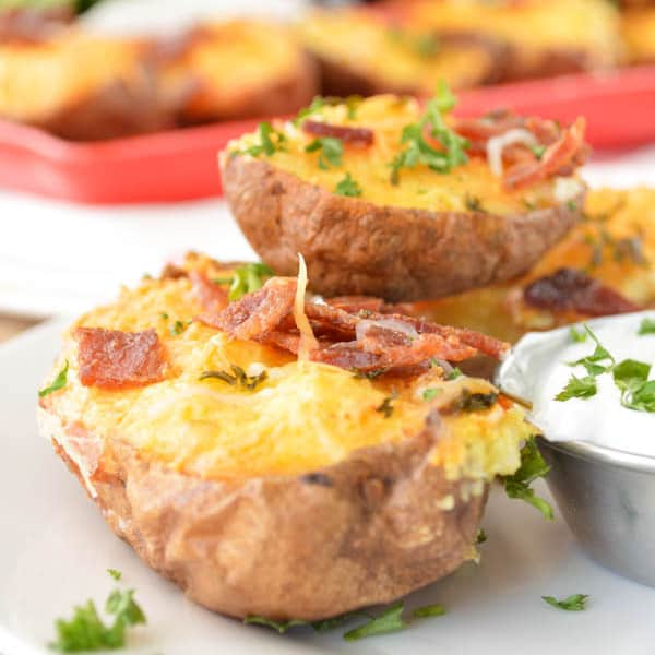 Twice Baked Breakfast Potatoes topped with bacon and parsley