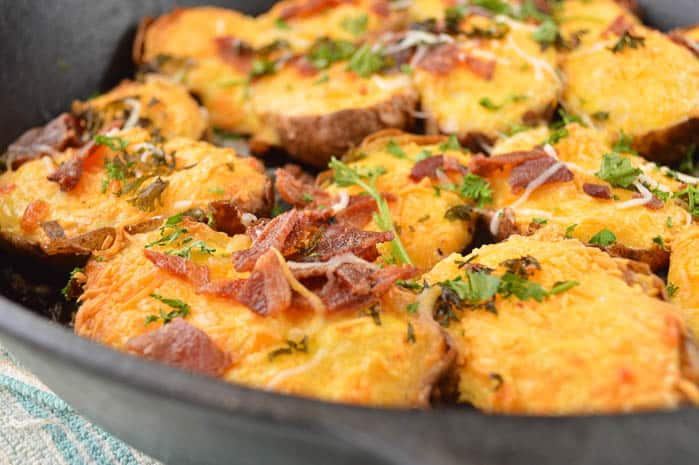 Twice Baked Breakfast Potatoes straight from the oven in a cast iron skillet