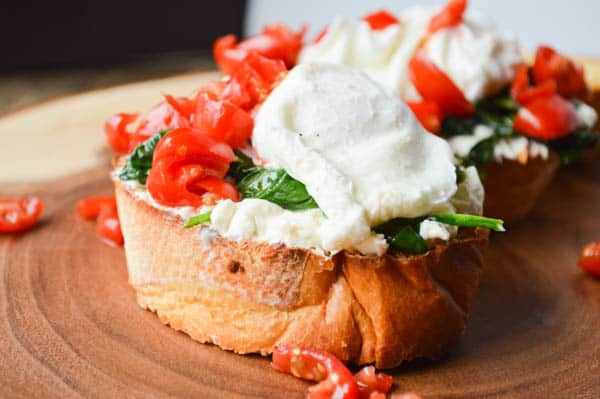 Whipped Feta Breakfast Crostini with a poached egg