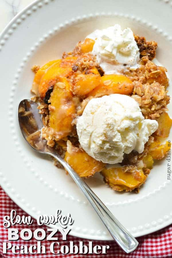 Slow Cooker Boozy Peach Cobbler is loaded with warm peaches, spiced rum, and a crumbly oat topping