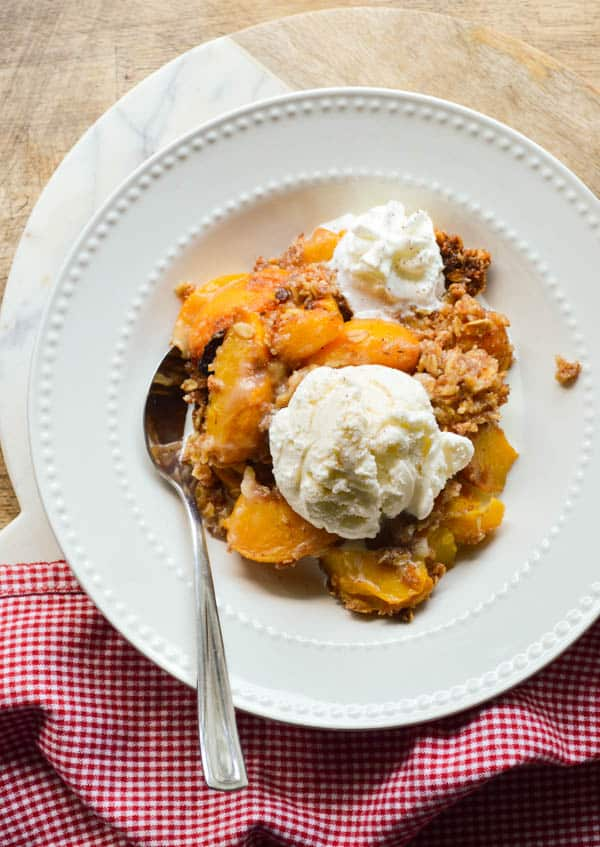 Slow cooked peaches with spiced rum and ice cream