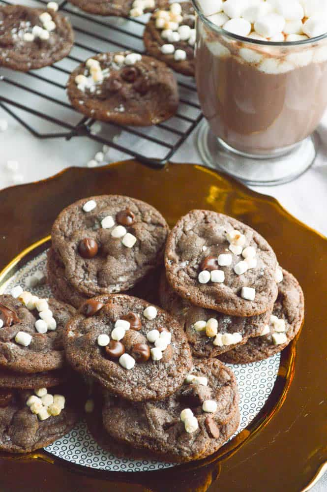 Hot Cocoa Cookies plated with a cup of hot cocoa