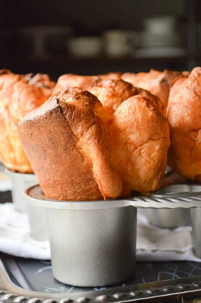 The Biggest Fattest Fluffiest Popovers vertical shot still in the pan so you can see just how tall they are