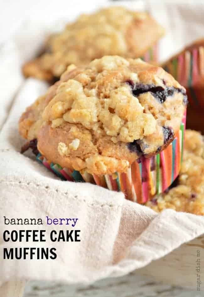 Banana Coffee Cake Muffins loaded with fresh berries and topped with a buttery brown sugar streusel - less that 200 calories each!