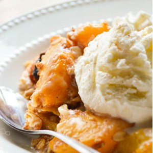Slow Cooker Boozy Peach Cobbler