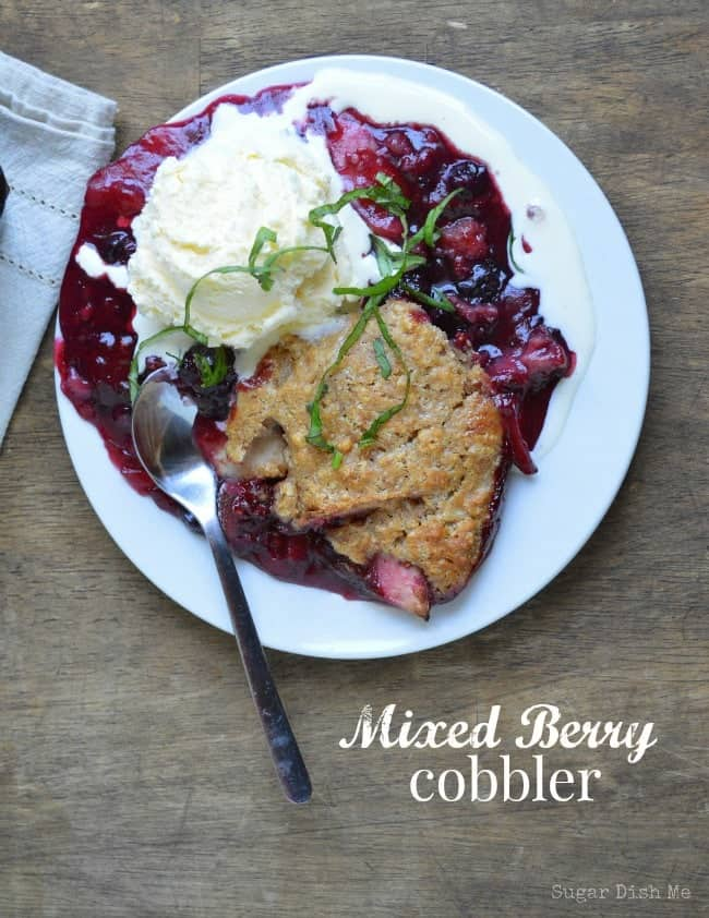 Mixed Berry Cobbler has a nutty oat crust and LOADS of berry filling. The perfect dessert no matter the time of year! #cobblerrecipe #crumblerecipe #strawberryrecipe #frozenberryrecipes #