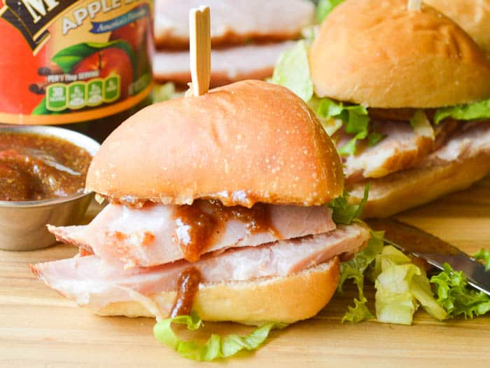 Small sandwiches piled high with apple butter glazed ham and speared with a toothpick for easy handling