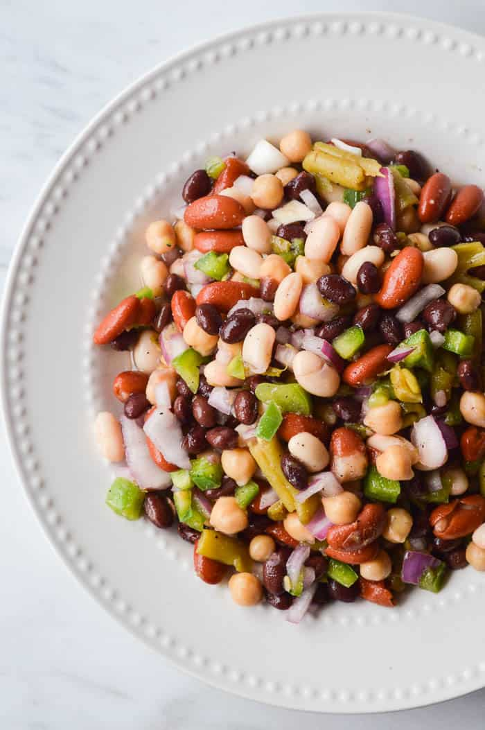 The Best Easy 5 Bean Salad shot from overhead in a simple white serving dish.