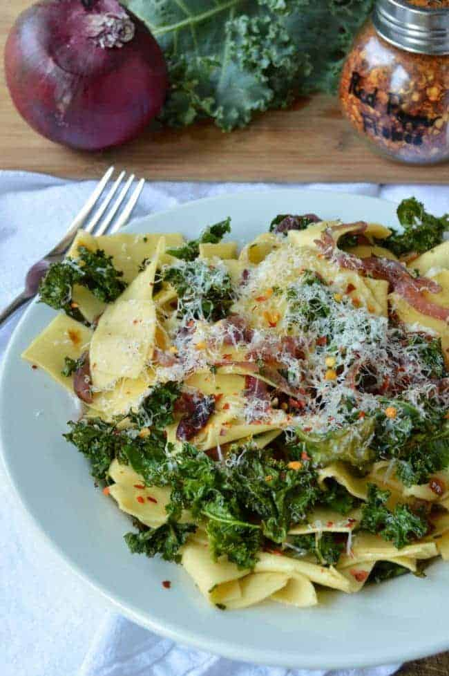 Pappardelle with Caramelized Onions and Crispy Kale is an easy 30 minute meal that's slightly sweet with a hint of spice. If you need a delicious meal on the cheap and fast, this pasta dish is just the thing.