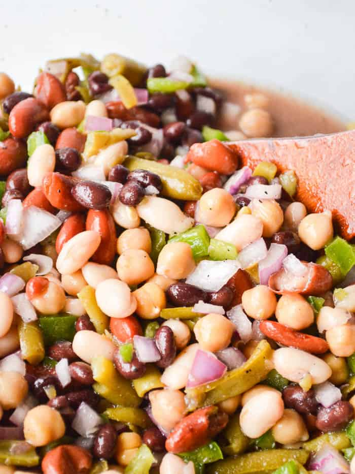 Stirring the ingredients together to make the Best Easy 5 Bean Salad.