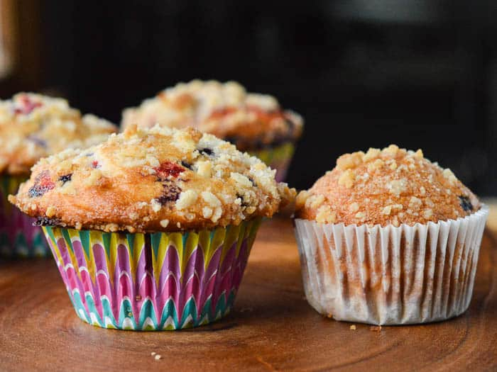 a side by side comparison of muffins. One is made with a box mix but with bakery-style tips, and the other is made following the box mix instructions