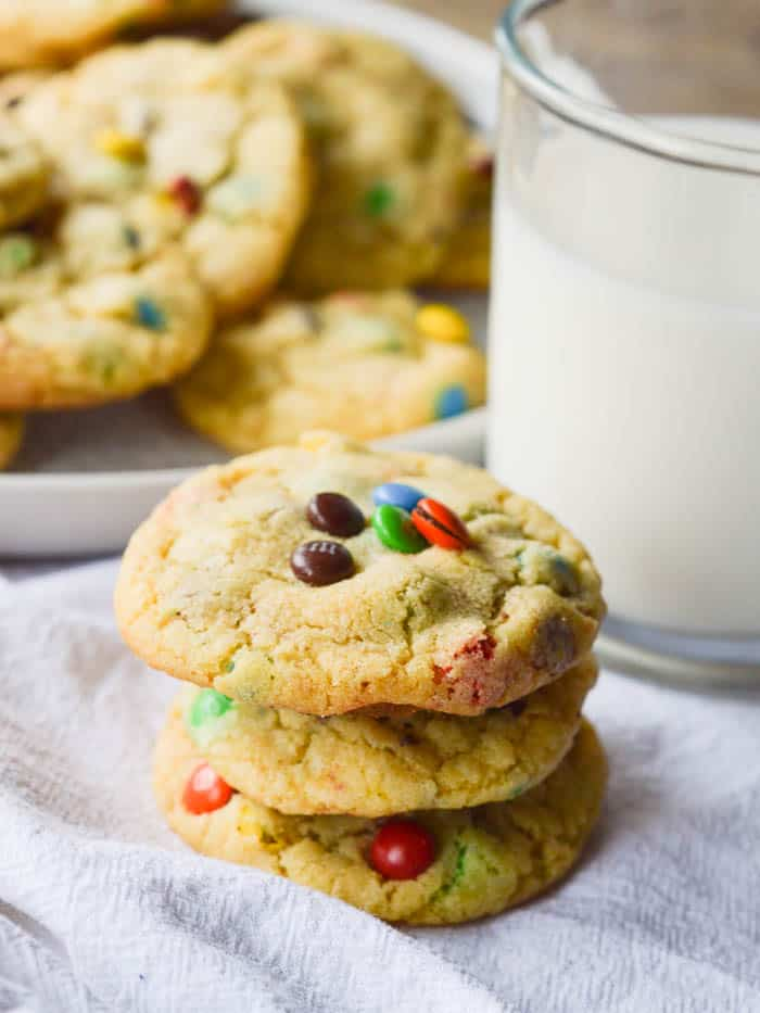 a stack of soft and chewy pudding cookies studded with M & M's