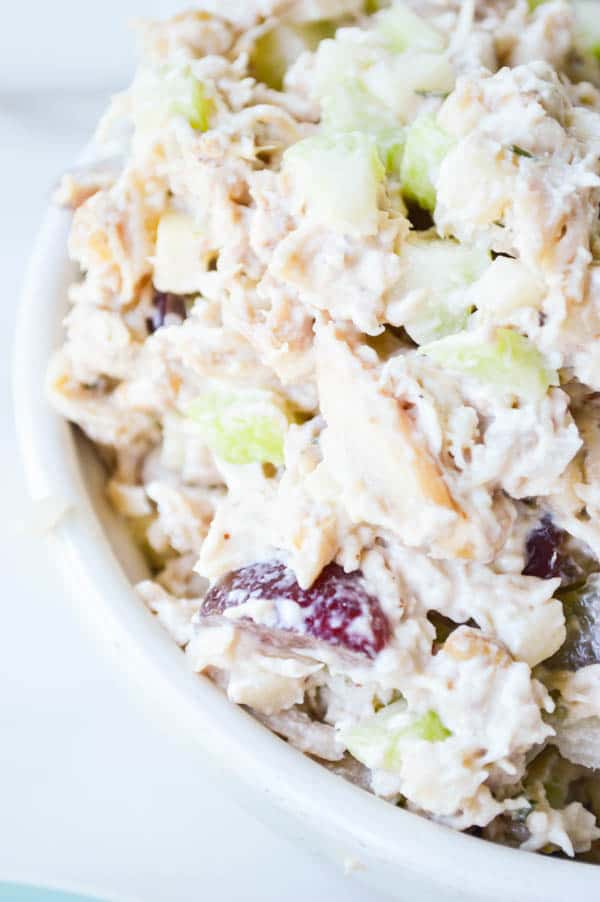 Bowl of Rotisserie Chicken Salad loaded with celery, grapes, apples, and a delicious creamy dressing