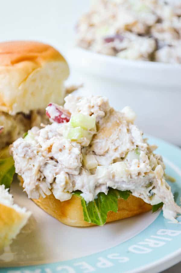 Soft Hawaiian rolls topped with the best rotisserie chicken salad loaded up with celery apples, grapes, and more