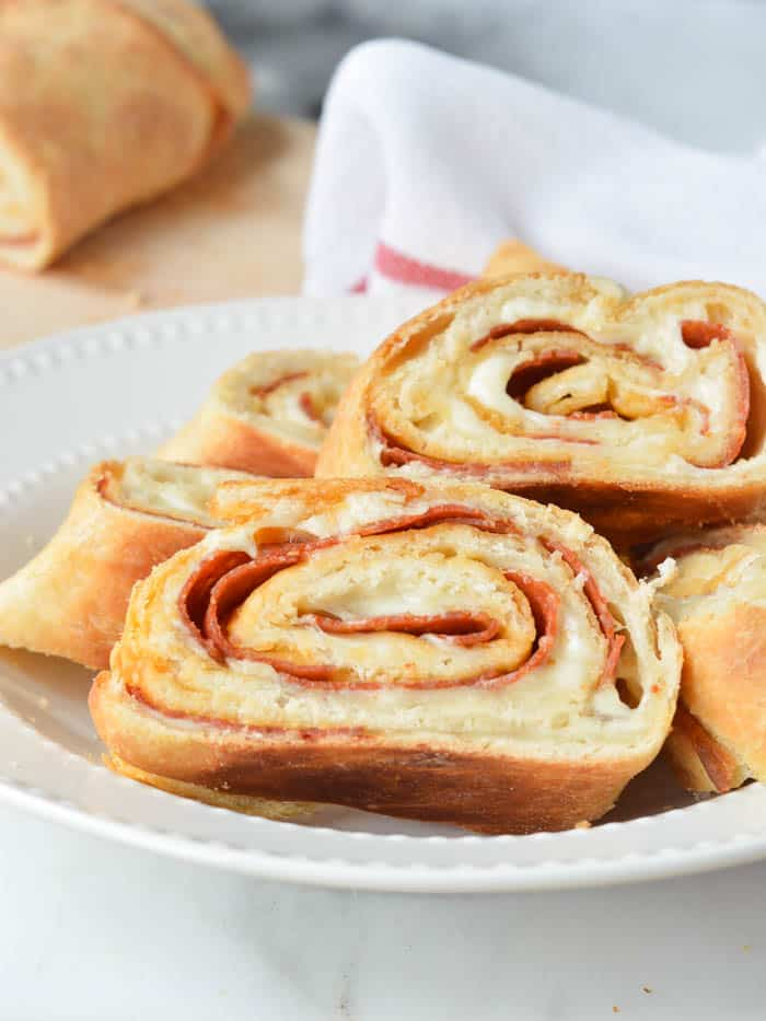 Easy Stromboli Recipe made from scratch, sliced in a white dish and ready to serve!