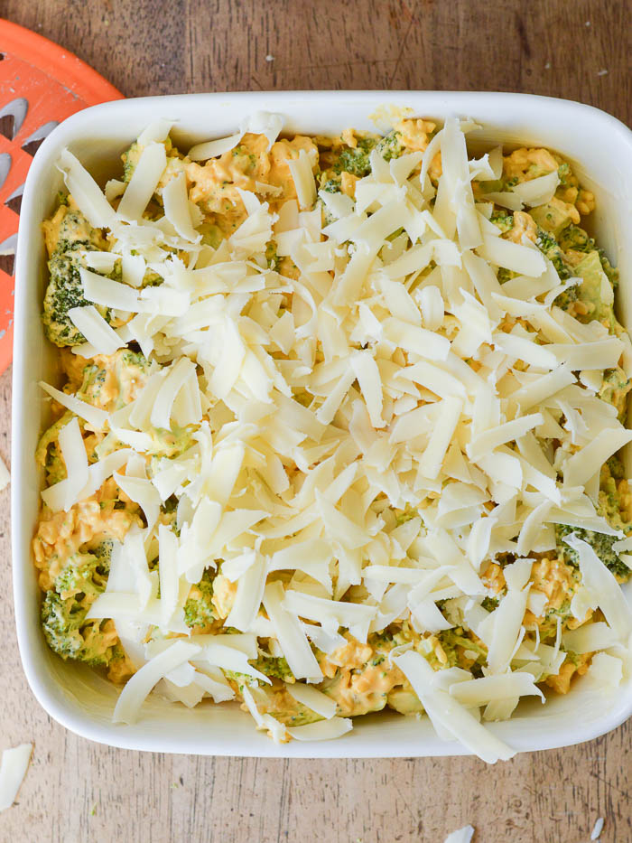 broccoli casserole topped with shredded cheddar and ready to bake. This classic recipe is easy to make ahead in just a few minutes.