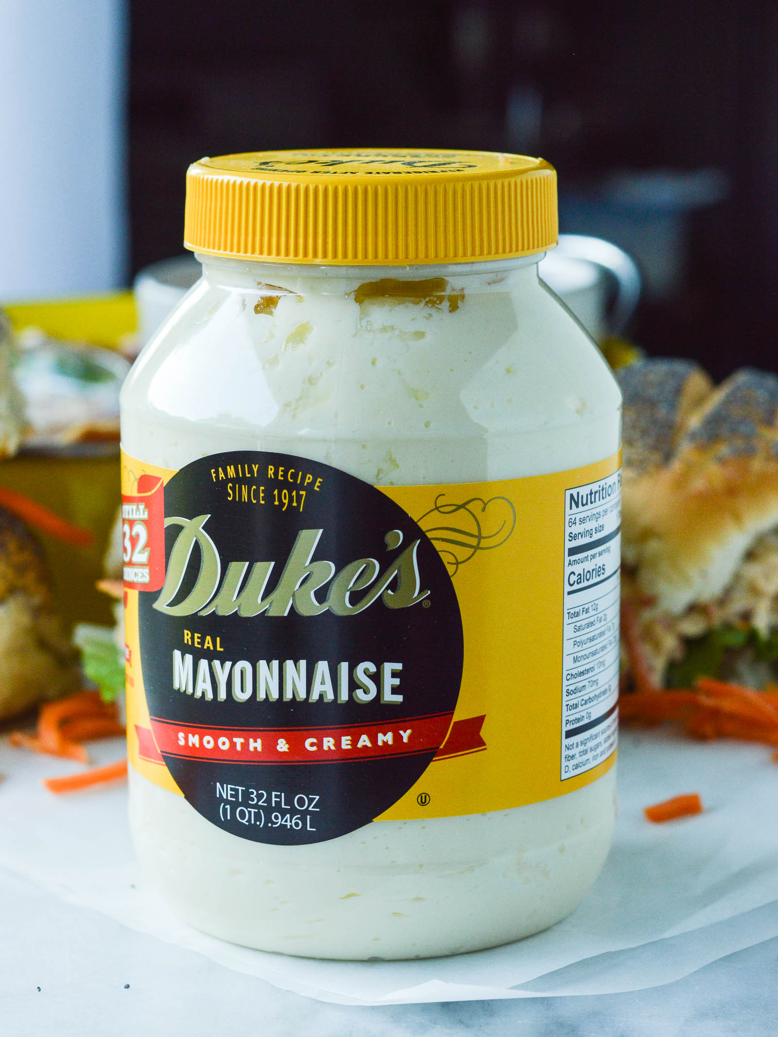 A jar of Duke's mayonnaise with Buffalo Chicken salad sandwiches in the background