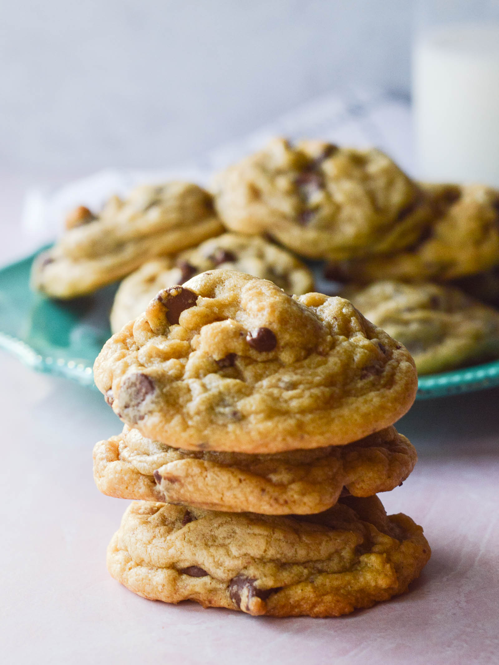 A stack of soft and perfectly wrinkly chocolate chip cookies made with pudding in the mix